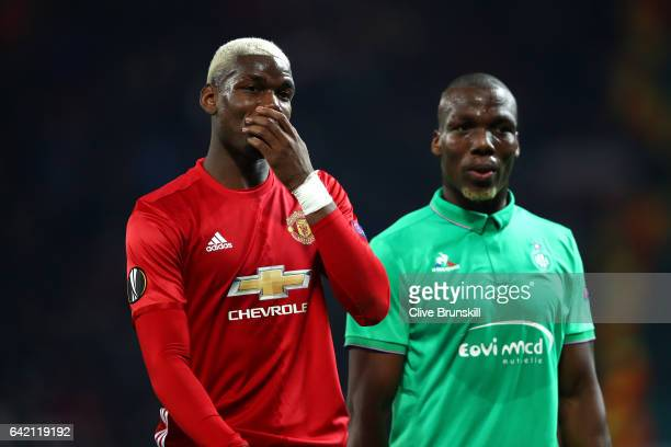 Paul Pogba of Manchester United and Florentin Pogba of SaintEtienne speak during the UEFA Europa League Round of 32 first leg match between...