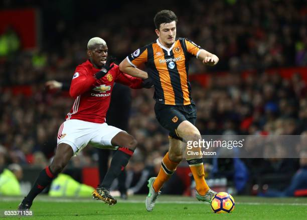 Paul Pogba of Manchester United and Harry Maguire of Hull City in action during the Premier League match between Manchester United and Hull City at...