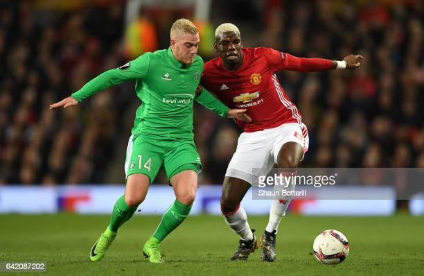 Paul Pogba of Manchester United and Jordan Veretout of SaintEtienne in action during the UEFA Europa League Round of 32 first leg match between...