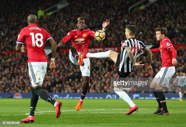 Paul Pogba of Manchester United and Joselu of Newcastle United battle for possession during the Premier League match between Manchester United and...