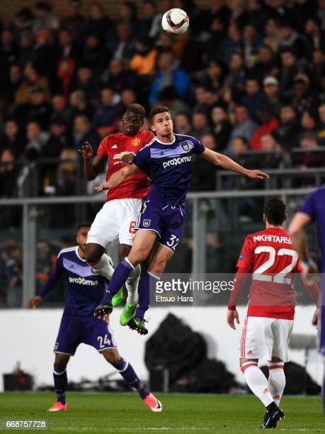 Paul Pogba of Manchester United and Leander Dendoncker of Anderlecht compete for the ball during the UEFA Europa League quarter final first leg match...