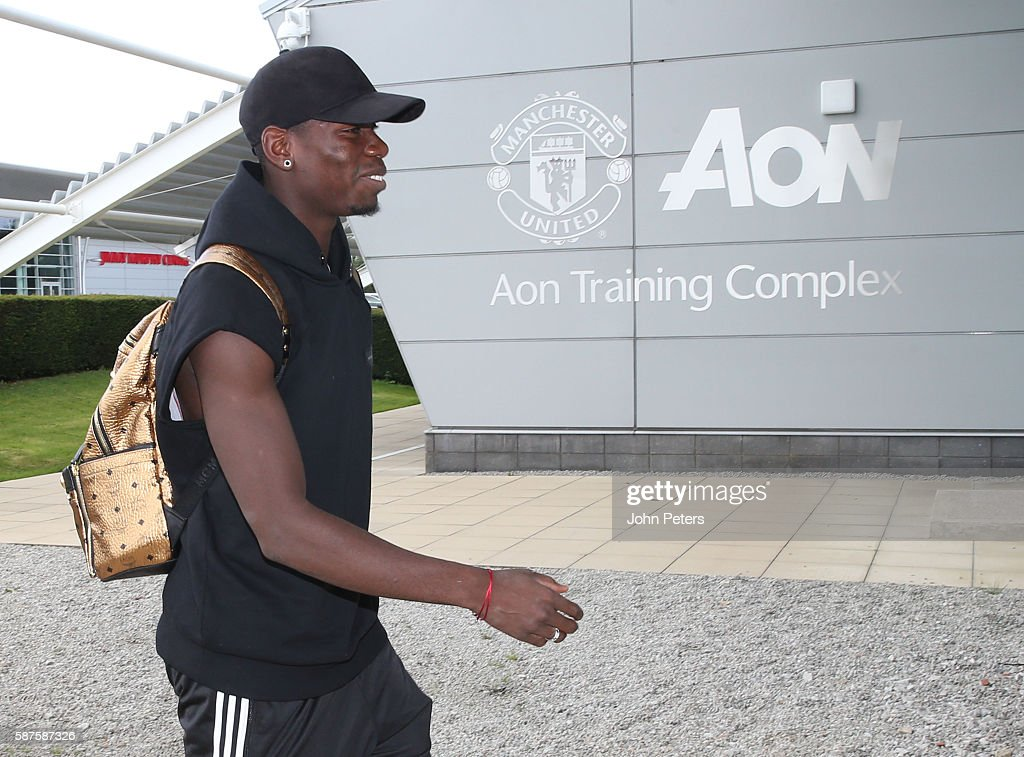 Paul Pogba of Manchester United arrives at Aon Training Complex before signing for the club at Aon Training Complex on August 8, 2016 in Manchester, England.