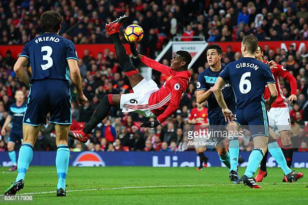 Paul Pogba of Manchester United attempts a scissor or bicycle kick shot on goal during the Premier League match between Manchester United and...