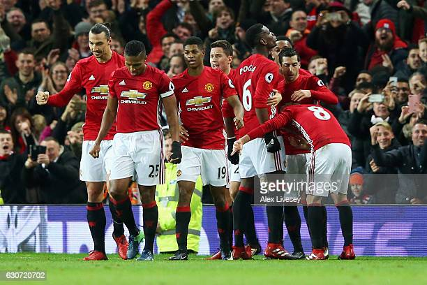 Paul Pogba of Manchester United celebrates after he scores a goal with team mates during the Premier League match between Manchester United and...