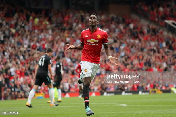 Paul Pogba of Manchester United celebrates after scoring a goal to make it 40 during the Premier League match between Manchester United and West Ham...