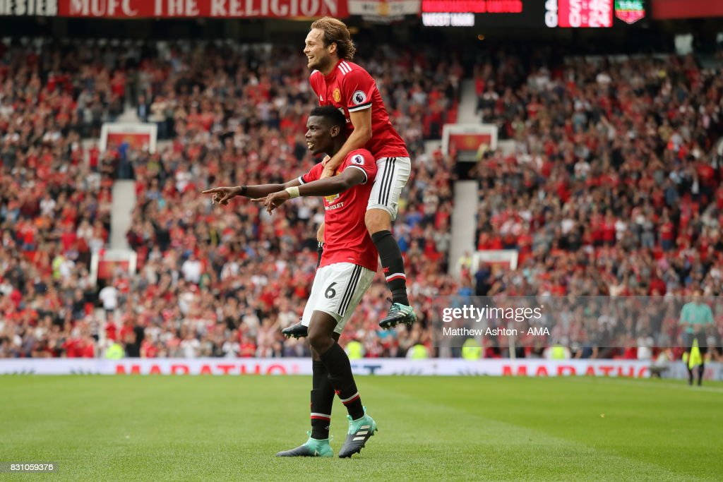 Paul Pogba of Manchester United celebrates after scoring a goal to make it 4-0 with Daley Blind during the Premier League match between Manchester United and West Ham United at Old Trafford on August 13, 2017 in Manchester, England.