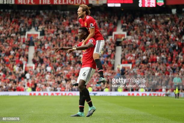 Paul Pogba of Manchester United celebrates after scoring a goal to make it 40 with Daley Blind during the Premier League match between Manchester...