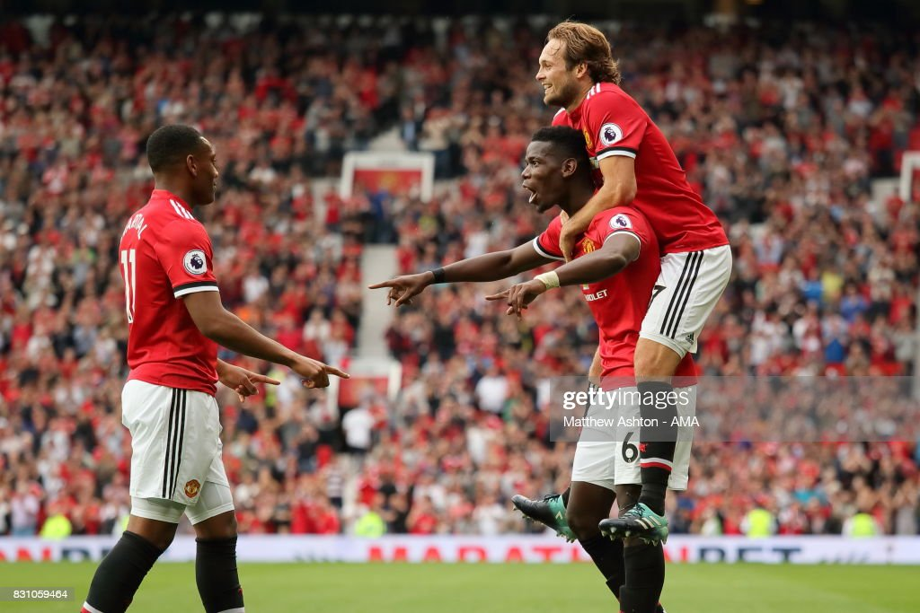 Paul Pogba of Manchester United celebrates after scoring a goal to make it 4-0 with Romelu Lukaku and Daley Blind during the Premier League match between Manchester United and West Ham United at Old Trafford on August 13, 2017 in Manchester, England.