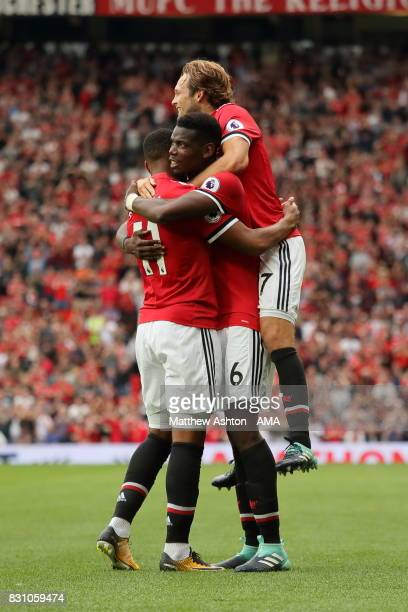 Paul Pogba of Manchester United celebrates after scoring a goal to make it 40 with Romelu Lukaku and Daley Blind during the Premier League match...