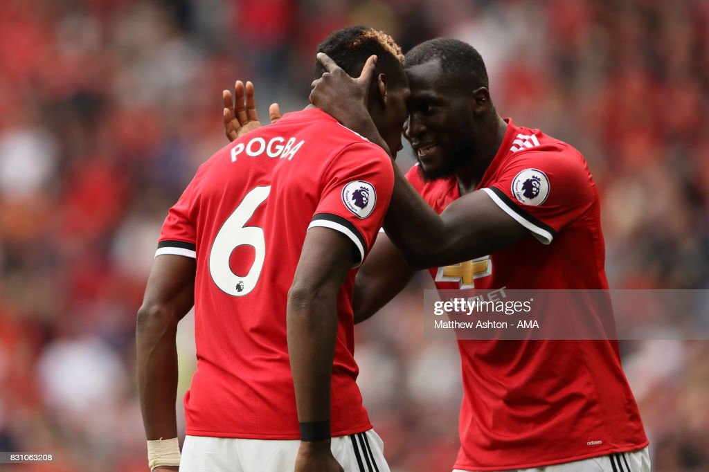 Paul Pogba of Manchester United celebrates after scoring a goal to make it 4-0 with Romelu Lukaku during the Premier League match between Manchester United and West Ham United at Old Trafford on August 13, 2017 in Manchester, England.