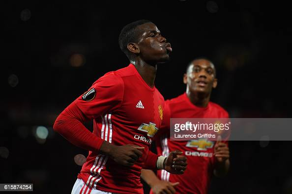 Paul Pogba of Manchester United celebrates after scoring the opening goal from the penalty spot during the UEFA Europa League Group A match between...