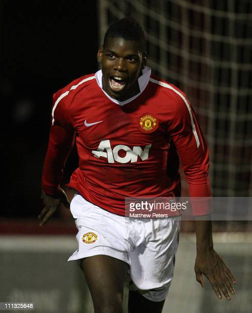 Paul Pogba of Manchester United celebrates after the Portsmouth goalkeeper scored an owngoal during the FA Youth Cup sponsored by Eon third round...