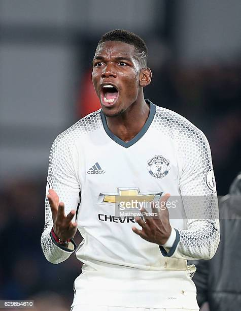 Paul Pogba of Manchester United celebrates after the Premier League match between Crystal Palace and Manchester United at Selhurst Park on December...