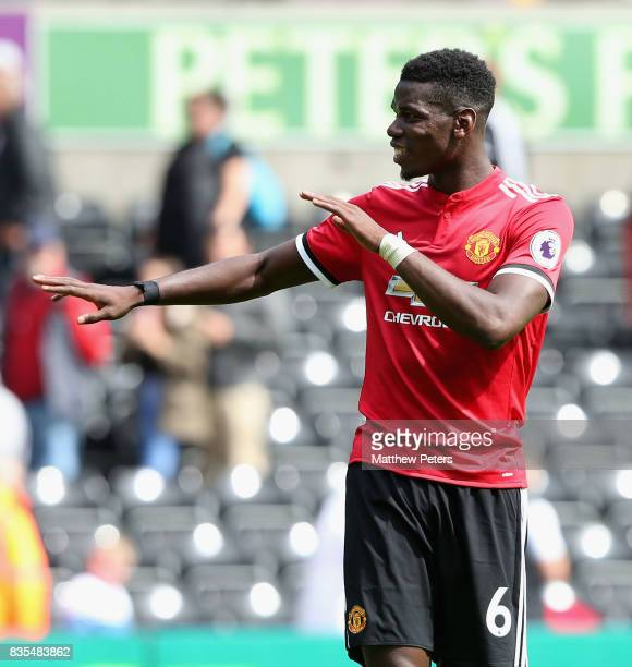 Paul Pogba of Manchester United celebrates after the Premier League match between Swansea City and Manchester United at Liberty Stadium on August 19...
