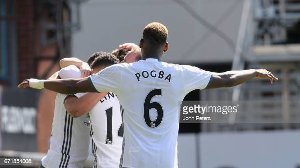 Paul Pogba of Manchester United celebrates Anthony Martial scoring their first goal during the Premier League match between Burnley and Manchester...