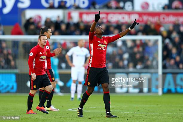 Paul Pogba of Manchester United celebrates scoring his sides first goal during the Premier League match between Swansea City and Manchester United at...