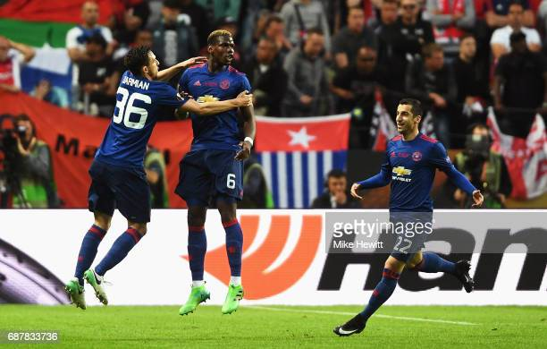 Paul Pogba of Manchester United celebrates scoring his sides first goal with Henrikh Mkhitaryan of Manchester United and Matteo Darmian of Manchester...
