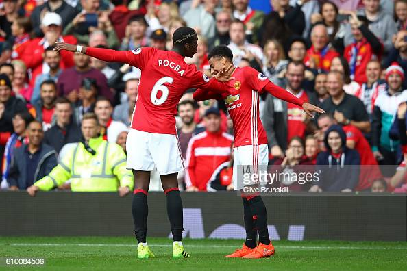 Paul Pogba of Manchester United celebrates scoring his sides fourth goal with Jesse Lingard of Manchester United during the Premier League match...