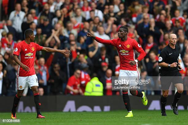 Paul Pogba of Manchester United celebrates scoring his sides fourth goal with Marcus Rashford of Manchester United during the Premier League match...
