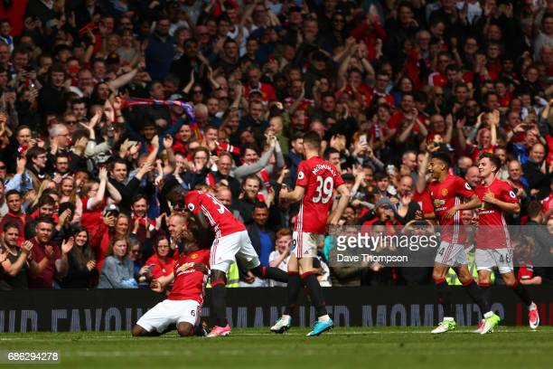 Paul Pogba of Manchester United celebrates scoring his sides second goal with his Manchester United team mates during the Premier League match...
