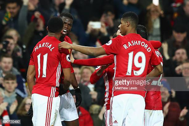 Paul Pogba of Manchester United celebrates scoring his teams second goal of the game with team mates Anthony Martial and Marcus Rashford during the...