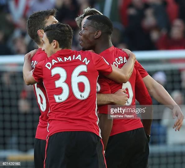 Paul Pogba of Manchester United celebrates scoring their first goal during the Premier League match between Swansea City and Manchester United at the...