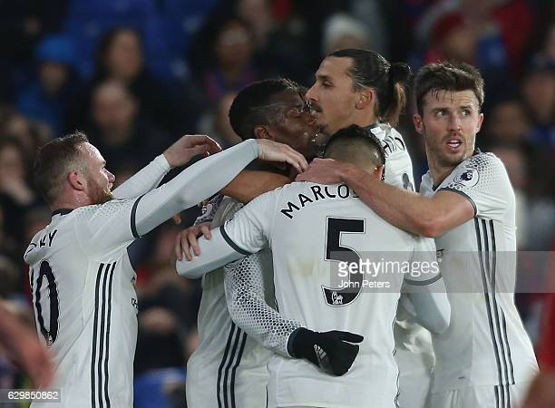 Paul Pogba of Manchester United celebrates scoring their first goal during the Premier League match between Crystal Palace and Manchester United at...