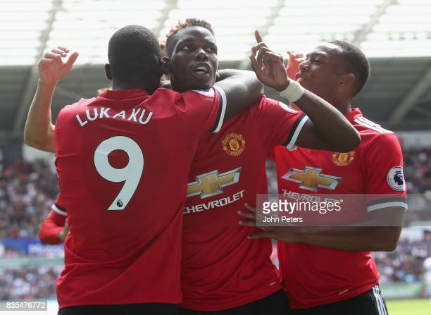 Paul Pogba of Manchester United celebrates scoring their third goal during the Premier League match between Swansea City and Manchester United at...