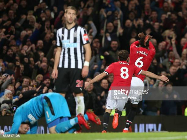 Paul Pogba of Manchester United celebrates scoring their third goal during the Premier League match between Manchester United and Newcastle United at...