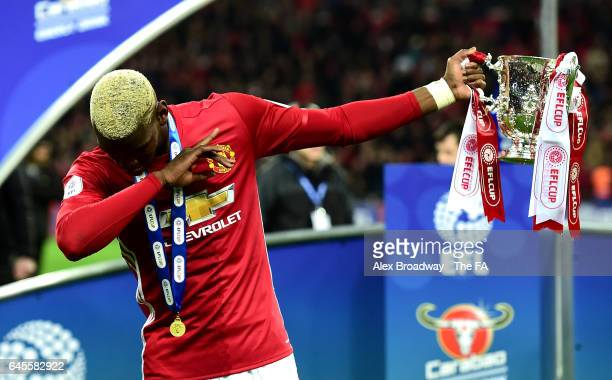 Paul Pogba of Manchester United celebrates victory with the trophy after during the EFL Cup Final between Manchester United and Southampton at...