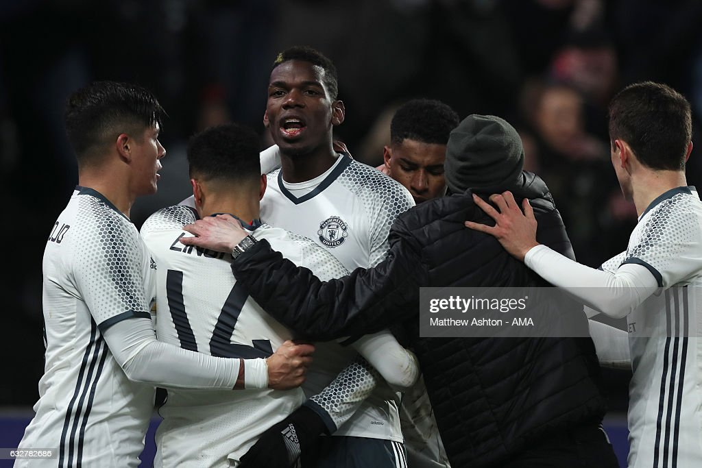 Paul Pogba of Manchester United celebrates with his team-mates after scoring a goal to make the score 1-1 during the EFL Cup Semi-Final second leg match between Hull City and Manchester United at KCOM Stadium on January 26, 2017 in Hull, England.
