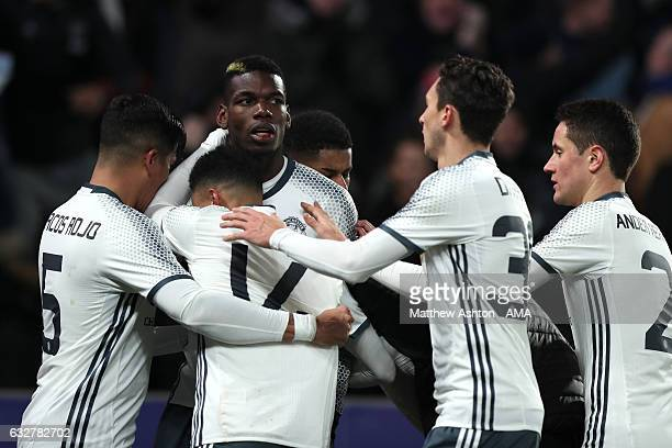 Paul Pogba of Manchester United celebrates with his teammates after scoring a goal to make the score 11 during the EFL Cup SemiFinal second leg match...