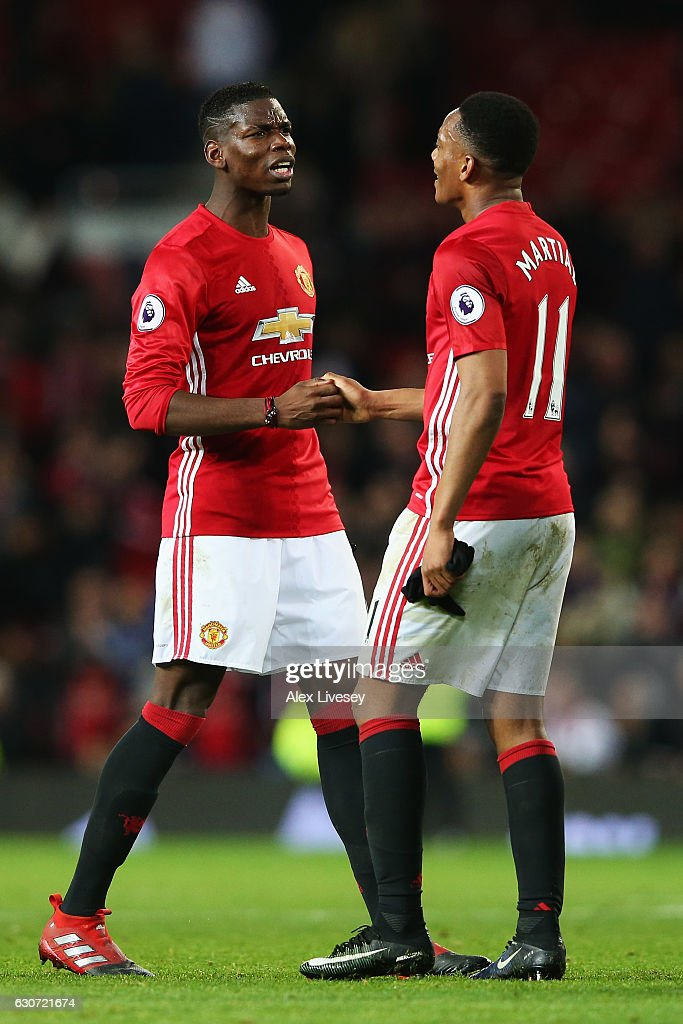 Paul Pogba of Manchester United celebrates with team mate Anthony Martial after victory in the Premier League match between Manchester United and Middlesbrough at Old Trafford on December 31, 2016 in Manchester, England.