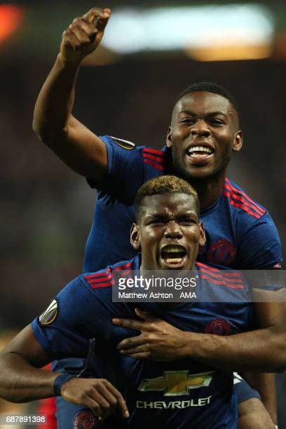 Paul Pogba of Manchester United celebrates with Timothy FosuMensah at the end of the UEFA Europa League Final between Ajax and Manchester United at...