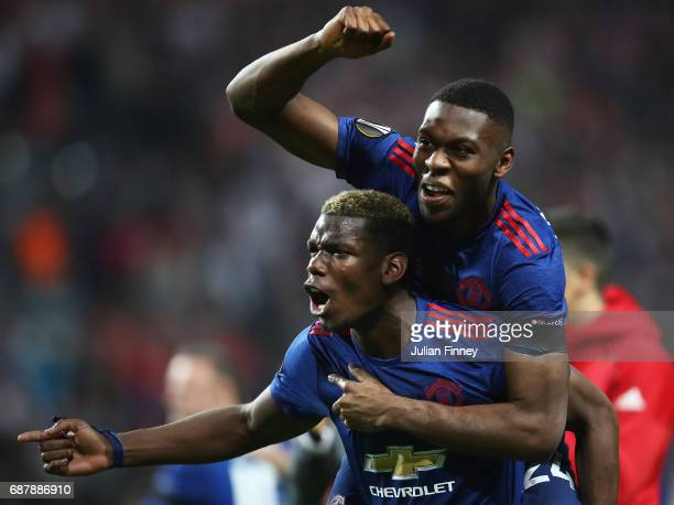 Paul Pogba of Manchester United celerbates with Timothy FosuMensah of Manchester United after the UEFA Europa League Final between Ajax and...