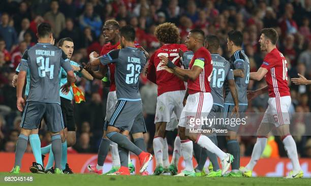 Paul Pogba of Manchester United clashes with Facundo Roncaglia of Celta Vigo during the UEFA Europa League semi final second leg match between...