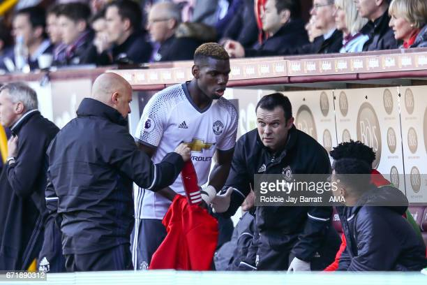 Paul Pogba of Manchester United comes off injured during the Premier League match between Burnley and Manchester United at Turf Moor on April 23 2017...