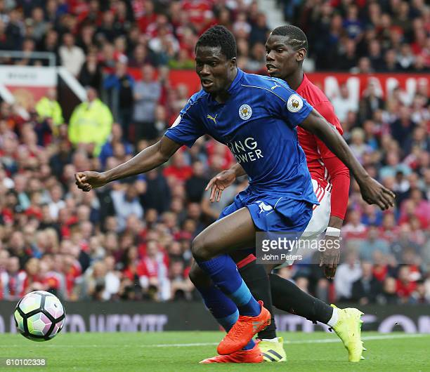 Paul Pogba of Manchester United competes with Daniel Amartey of Leicester during the Premier League match between Manchester United and Leicester...