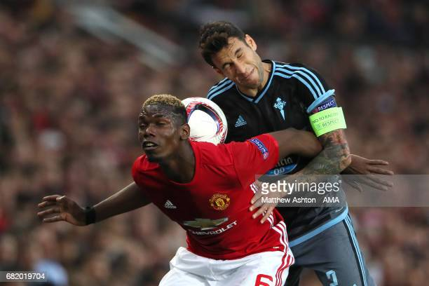Paul Pogba of Manchester United competes with Hugo Mallo of Celta Vigo during the UEFA Europa League semi final second leg match between Manchester...