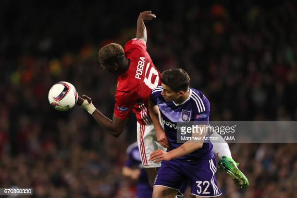 Paul Pogba of Manchester United competes with Leander Dendoncker of Anderlecht during the UEFA Europa League quarter final second leg match between...