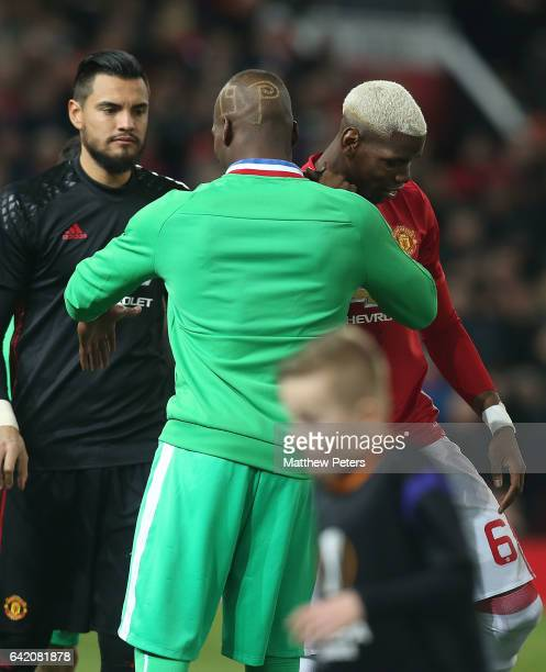 Paul Pogba of Manchester United greets his brother Florentin Pogba of AS SaintEtienne ahead of the UEFA Europa League Round of 32 first leg match...