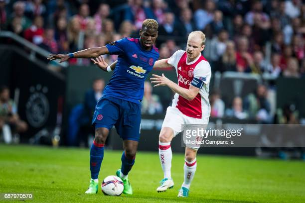 Paul Pogba of Manchester United in a duel with Davy Klaassen of Ajax during the UEFA Europa League final between Ajax and Manchester United at...