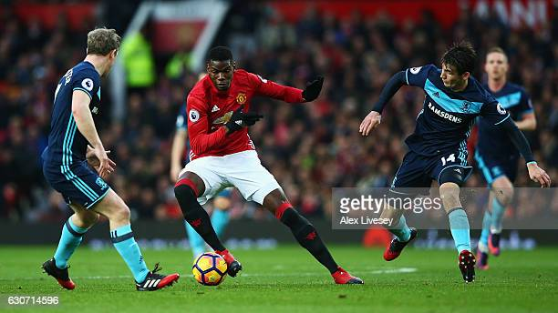 Paul Pogba of Manchester United in action against Grant Leadbitter and Marten de Roon of Middlesbrough during the Premier League match between...