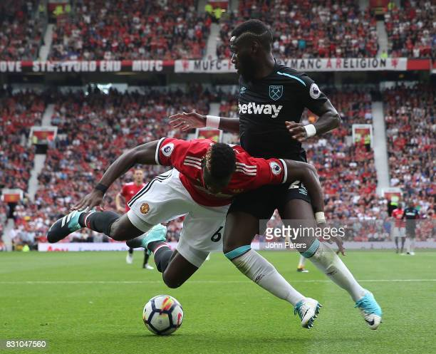 Paul Pogba of Manchester United in action with Arthur Masuaku of West Ham United during the Premier League match between Manchester United and West...