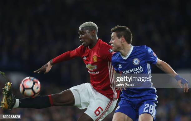 Paul Pogba of Manchester United in action with Cesar Azpilicueta of Chelsea during the Emirates FA Cup QuarterFinal match between Chelsea and...