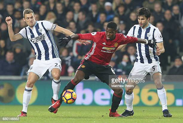 Paul Pogba of Manchester United in action with Darren Fletcher and Claudio Yacob of West Bromwich Albion during the Premier League match between West...
