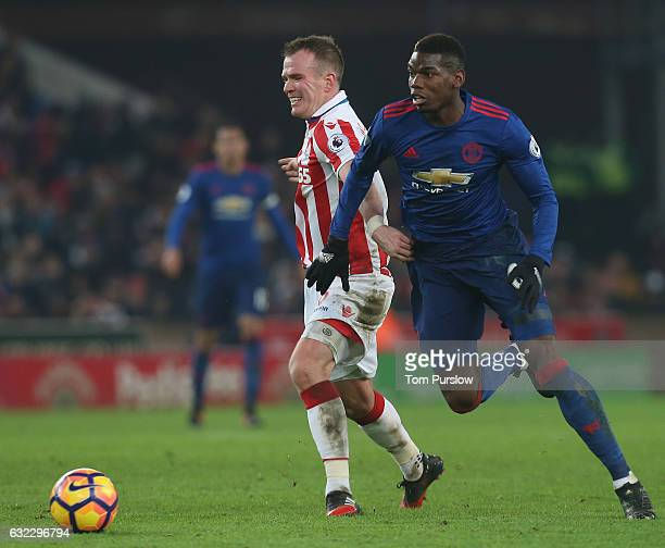 Paul Pogba of Manchester United in action with Glenn Whelan of Stoke City during the Premier League match between Stoke City and Manchester United at...