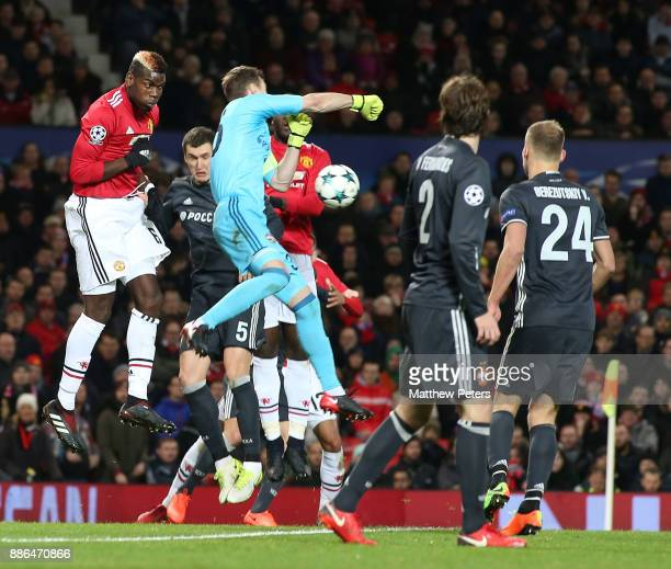 Paul Pogba of Manchester United in action with Igor Akinfeev of CSKA Moscow during the UEFA Champions League group A match between Manchester United...