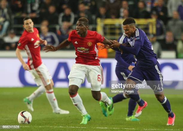 Paul Pogba of Manchester United in action with Isaac Thelin of ASC Anderlecht during the UEFA Europa League quarter final first leg match between RSC...