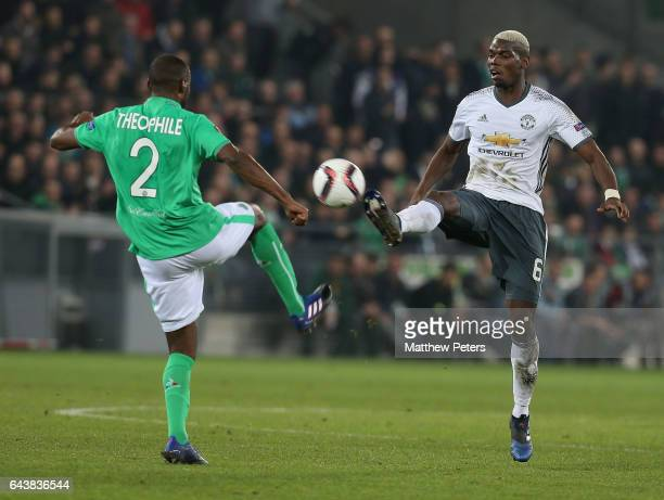 Paul Pogba of Manchester United in action with Kevin TheophileCatherine of AS SaintEtienne during the UEFA Europa League Round of 32 second leg match...